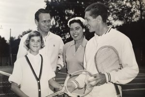 Susan Snyder (WTC girls junior champion), Jack Kramer, Ruth Hancock (WTC president) and Tony Trabert